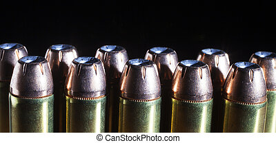 Hollow point bullets - Cartridges for a forty four magnum...