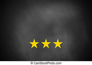 three golden stars on black chalkboard - three golden rating...