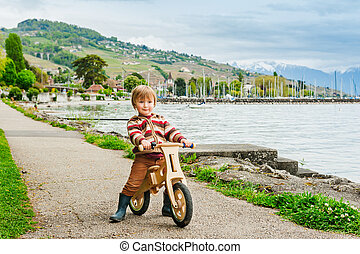 Cute little toddler boy playing outdoors