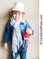 Portrait of a cute toddler boy, wearing hat and scarf