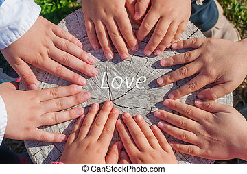 Hands and Love - The hands of a few childrens over an old...