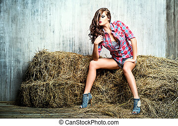 sultry woman - Seductive young woman in jeans shorts and a...