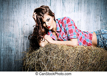 western style - Seductive young woman in jeans shorts and a...