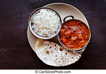 Indian food - Chicken tikka masala served with rice on the...