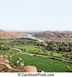 Hampi - Landscape of Hampi rocks and rice fields