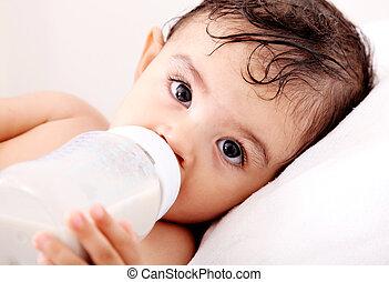 Baby milk - Baby drinking milk of her bottle White...
