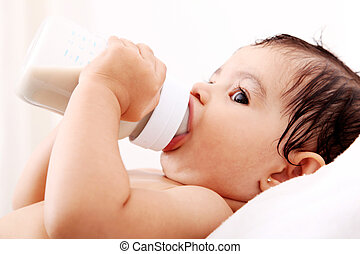 Babys bottle - Baby drinking milk of her bottle White...
