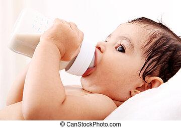 Babys bottle - Baby drinking milk of her bottle White...