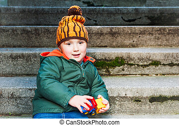 Outdoor, portrait of a cute toddler boy