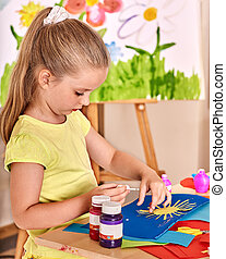 Child girl glue in preschool. - Child girl glue paper in...