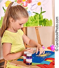 Child girl glue in preschool. - Child girl glue paper in...