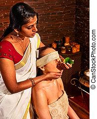 Woman having ayurveda spa treatment - Woman having nose...