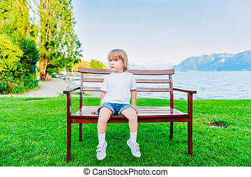 Cute toddler boy playing outdoors