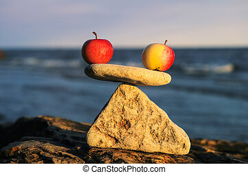 Zen-like - Balancing of two apples on the top of stone