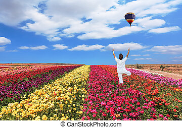 Balloon flies over a field - Buttercups blooming garden. An...