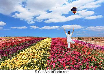 Balloon flies over a field - Buttercups blooming garden. An...