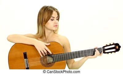 An attractive young teenage woman with an acoustic guitar on...