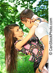 girl embraces guy in the woods