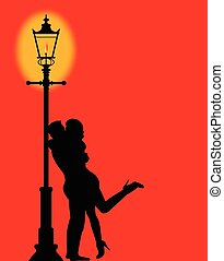 Kissing Under the Lamppost - A couple kissing under the...