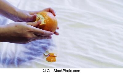 Man cleans orange An accelerated - Human hands clean orange...