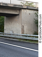 damaged concrete highway bridge