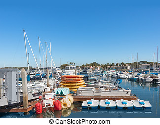 Boat and kayak rentals in busy marina - Reflections of boats...