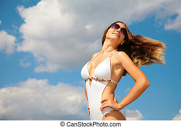 Girl in bathing suit with fluttered hair