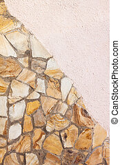 yellow stone wall with pink plaster