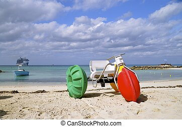 Colorful water trike - A colorful water trike is parked on...