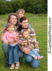 Family of five portrait on grass