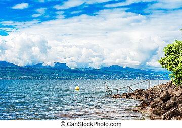 Lake Geneva with Alps and amazing clouds