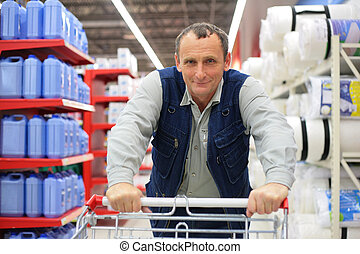 Man in supermarket with shopping cart