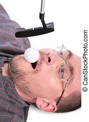 Lying man holds golf ball in mouth for boss