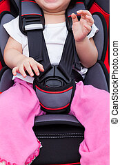 Girl sitting at carseat and fasten seat belt - Image of...