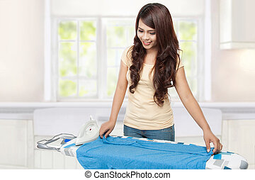 young asian woman doing the laundry