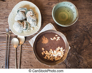Korean desserts set with Tteok, Red bean porridge,and tea