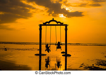 Gili Gate - Beautifull Gate with girls swing above ocean...