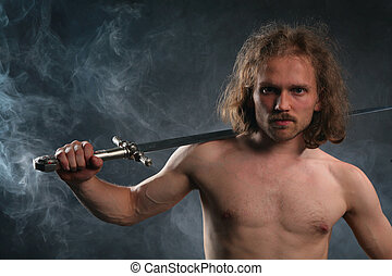 Man with sword in smoke