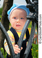 child from metal fence