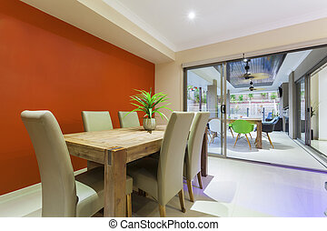 Dining table and outdoor entertaing area in stylish home