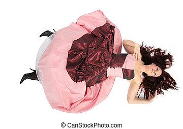 Lying beautiful woman in luxurious dress