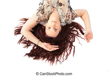 Lying woman with brown hair top view