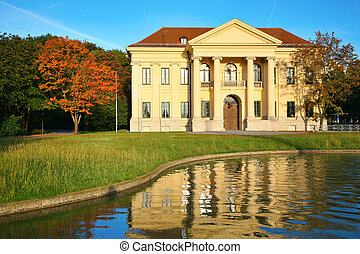 Mansion at reservoir. Munich. Germany.