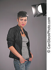 Portrait of young beauty woman in photostudio