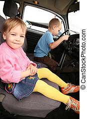 Little Girl and boy in car
