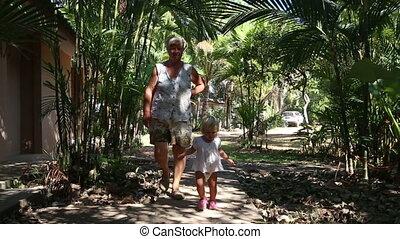 grandmother follows blonde toddler girl - grandmother...
