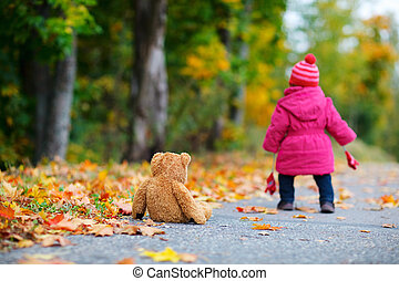 Toddler girl outdoors - Cute 1 year old girl walking...