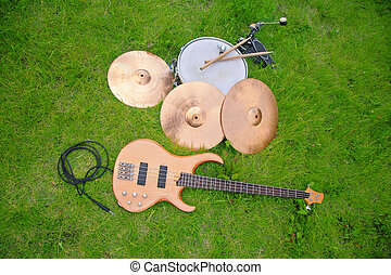 musical instruments, guitar, drum, plates on grass
