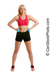 Smiling blonde athlete posing with dumbbells
