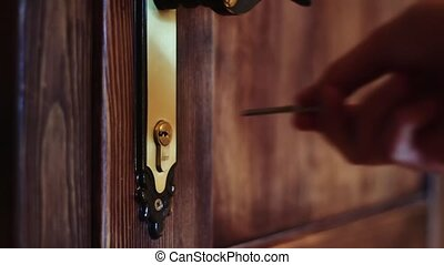 The man opens the door using the key - Inserting a hand into...